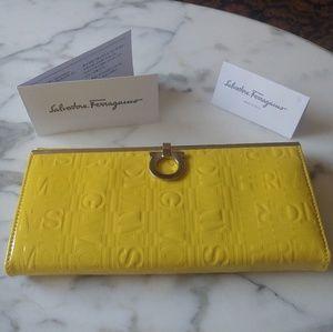 Brand new Ferragamo wallet in patent limone yellow
